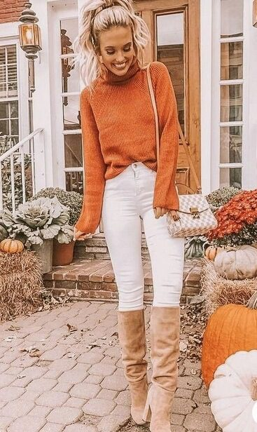 woman wearing a Orange sweater with white jeans and over-the-knee cream boots.