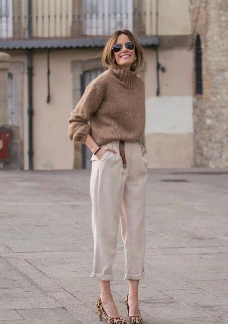 woman wearing a Monochrome look: Cream pants with khaki sweater and leopard pointy shoes.