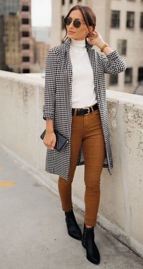 woman wearing a Checkered midi coat with white shirt and camel jeans.