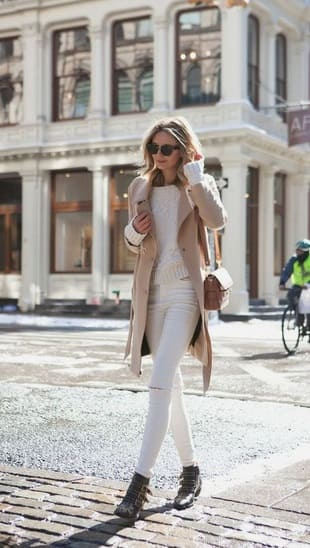 woman wearing a Another monochromatic look: All white with cream midi coat