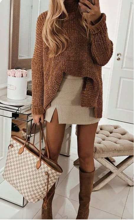 woman wearing a Brown  tones: White, checkered short skirt with brown sweater and brown boots and a matching bag.