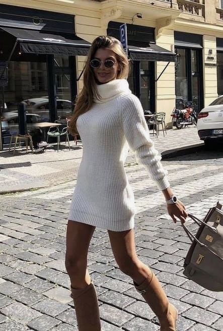 Elegant fall outfits: woman wearing a Figure-hugging white, wool dress with knee-high brown boots