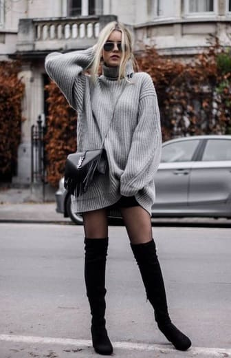 woman wearing a Oversized grey sweater with over-the-knee black boots