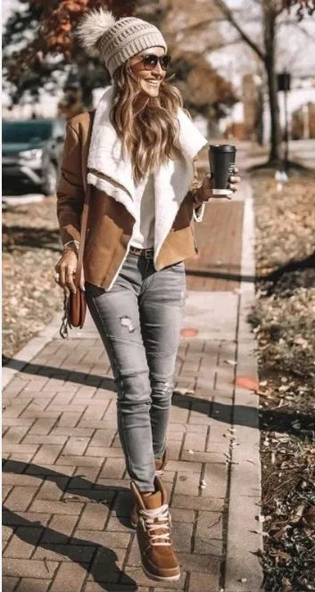woman wearing a Sporty and Casual Autumn Outfit holding a coffee takeaway