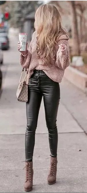 Elegant fall outfits: woman wearing a Casual Fall Outfit with black leather pants and a light pink sweater