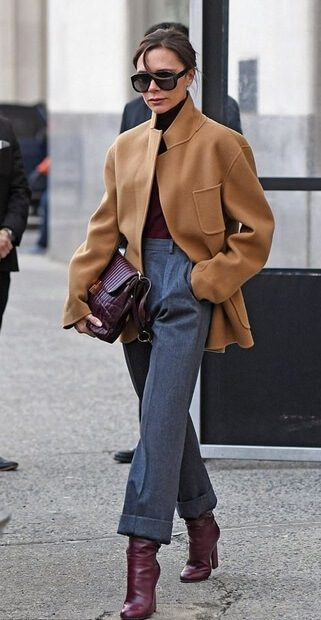 Elegant fall outfits: Victoria Beckham wearing a High-wasted jeans burgundy boots with matching burgundy bag and shirt.