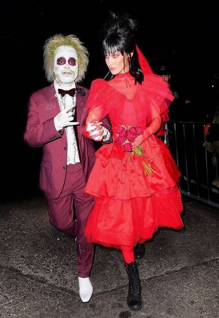 Beetlejuice and Lydia   Looking for iconic couples costume Halloween ideas for 2020? Find the best couples Halloween costume ideas, perfect for matching with your boyfriend. Find hot couples costume ideas, cool Disney characters costumes and the best DIY, funny, and scary couples Halloween costume inspiration.  #CouplesCostumeHalloween #couplescostume #halloweencouples #halloween