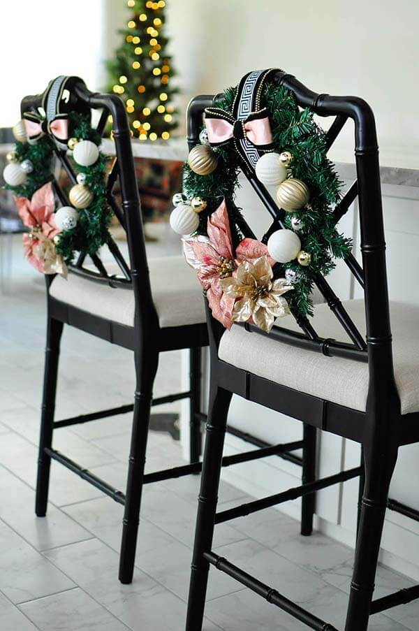 Chair Decorations | Want ideas for a themed Christmas decor this year? There is nothing more elegant and feminine that pink gold decor and the sky is the limit when looking for pink gold Christmas decoration. From pink Christmas tree, elegant gold pink Christmas decoration and ornaments, gold pink xmas wreaths, gold pink ideas DIY and the cutest gold pink Christmas decor from the dollar store. #pinkchristmas #pinkgoldchristmas #pinkchristmasdecor #pinkchristmasaesthetic #themedchirstmas