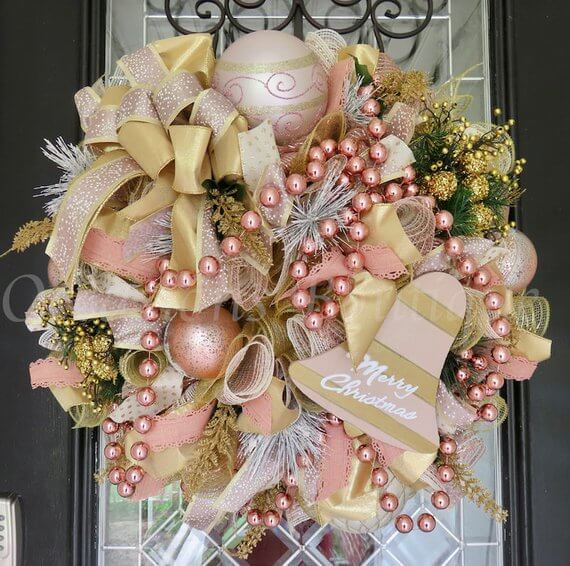 Stunning Pink Gold Christmas Wrath | Want ideas for a themed Christmas decor this year? There is nothing more elegant and feminine that pink gold decor and the sky is the limit when looking for pink gold Christmas decoration. From pink Christmas tree, elegant gold pink Christmas decoration and ornaments, gold pink xmas wreaths, gold pink ideas DIY and the cutest gold pink Christmas decor from the dollar store. #pinkchristmas #pinkgoldchristmas #pinkchristmasdecor #pinkchristmasaesthetic #themedchirstmas