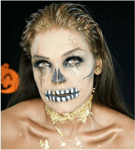 Sexy Skull Makeup with Golden Glitter pretty halloween makeup idea for girls
