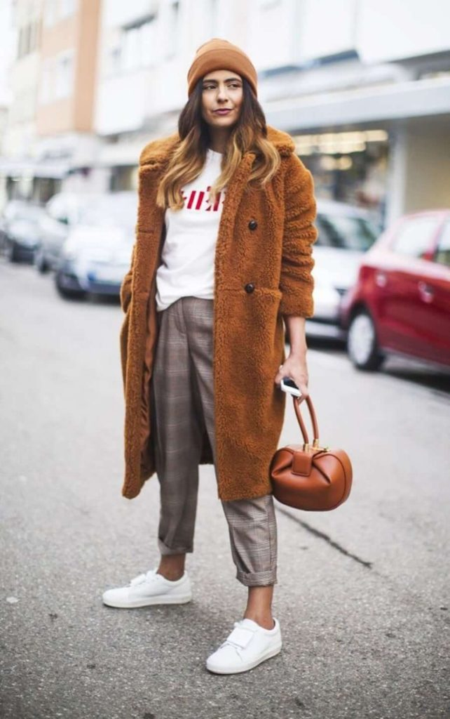 Elegant fall outfits: woman wearing a Casual & Cute Fall Outfit : oversized camel coat, white shirt and brown beanie