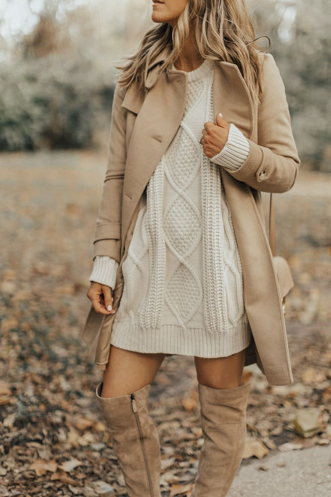 Elegant fall outfits: woman wearing a Egg shell sweater dress with over-the-knee cream boots