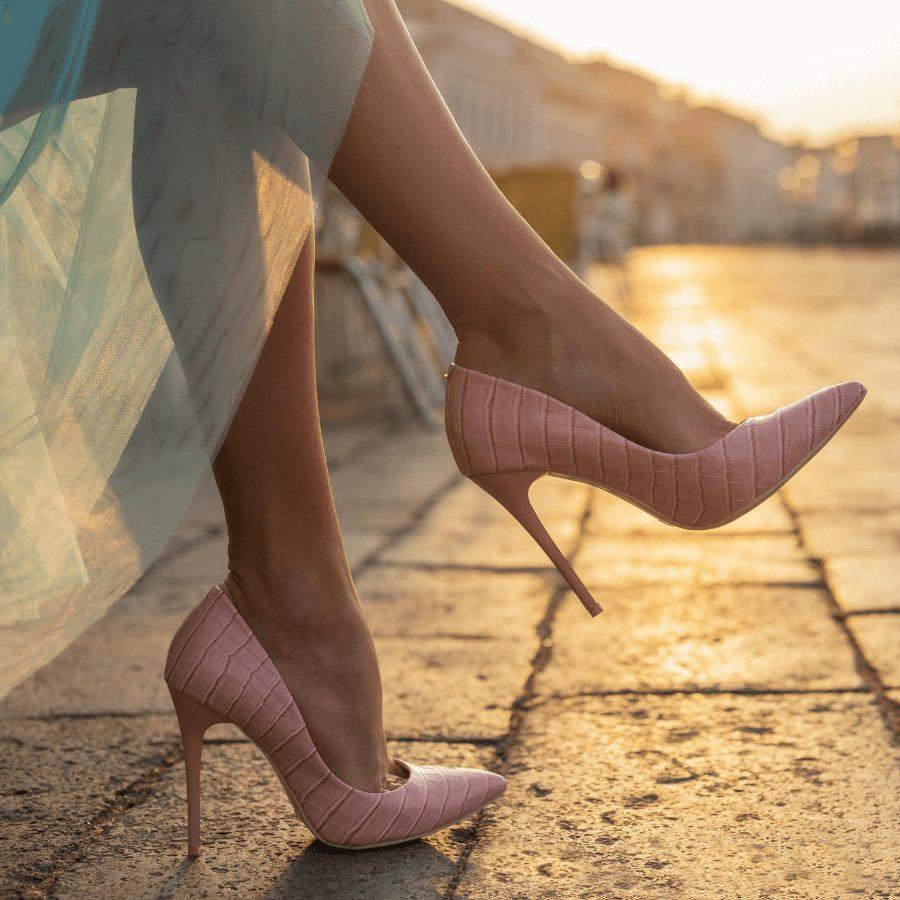crossed legs against th sunlight in pink high heels