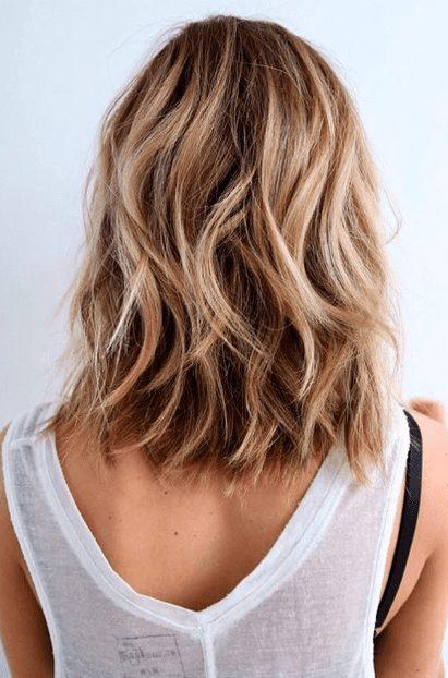 Girl facing backwards with beautiful beachy hair waves