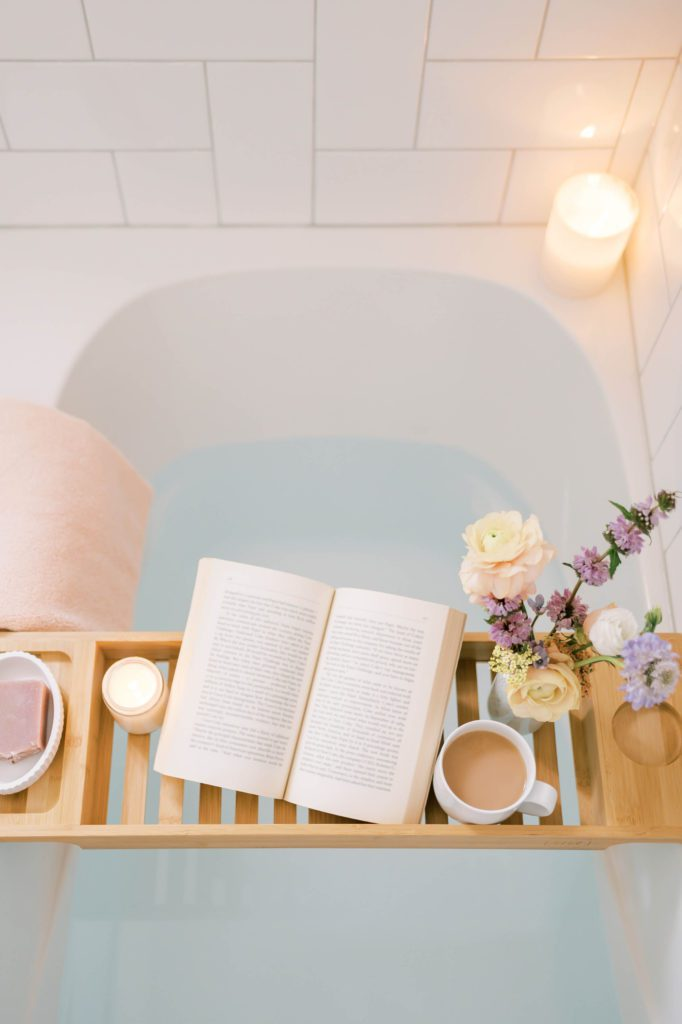 Self-care betahrub with flowers, book and tea, perfect for Personal Transformation