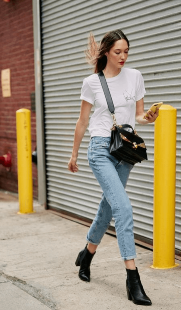denim with black cowboy boots street style