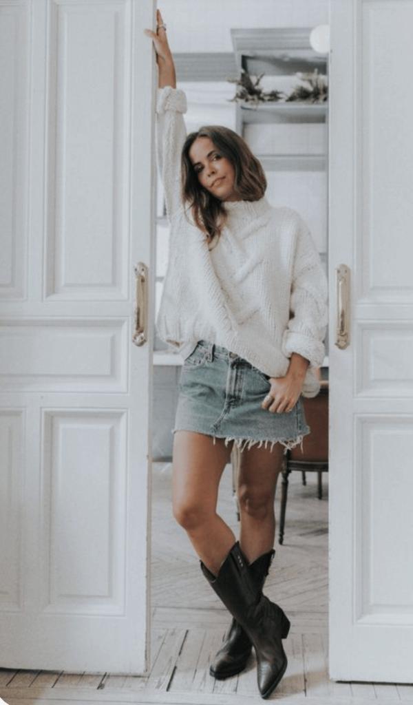 denim skirt with black cowboy boots