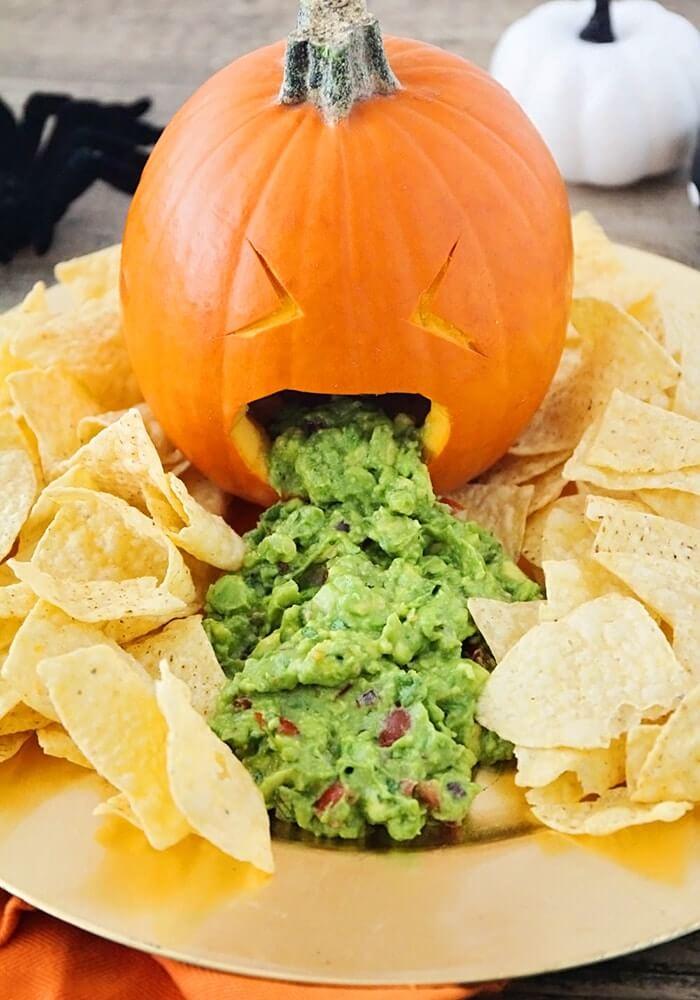 Healthy Halloween Throwing Up Pumpkin Guacamole